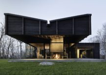 Cantilevered-structure-of-the-modern-house-gives-it-a-distinct-facade-217x155