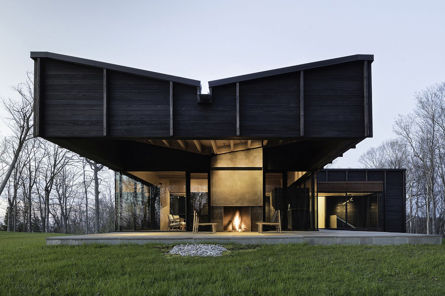 Cantilevered structure of the modern house gives it a distinct facade