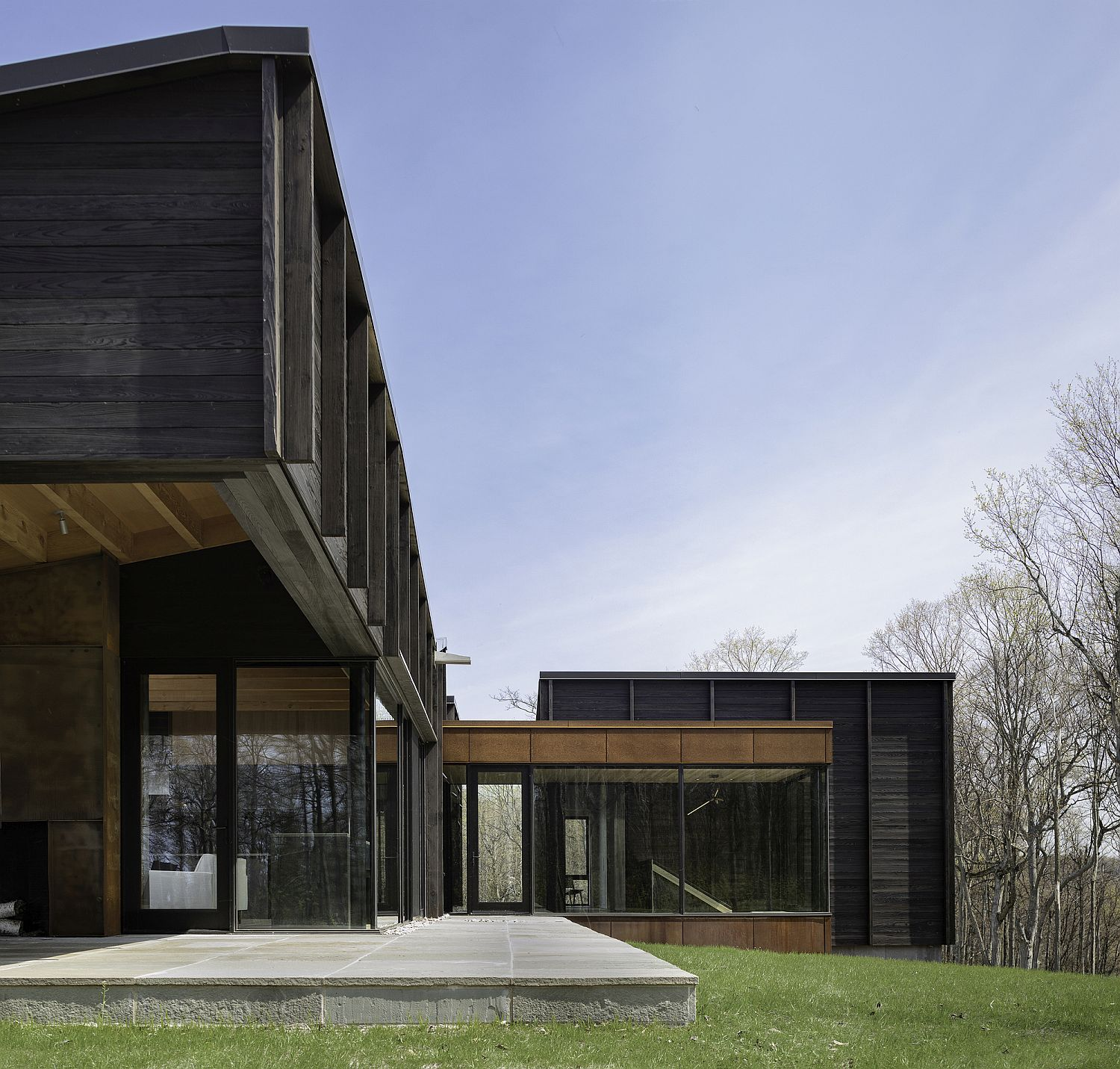 Charred wood exterior of the stylish Michigan Lake House with a sweeping modern interior
