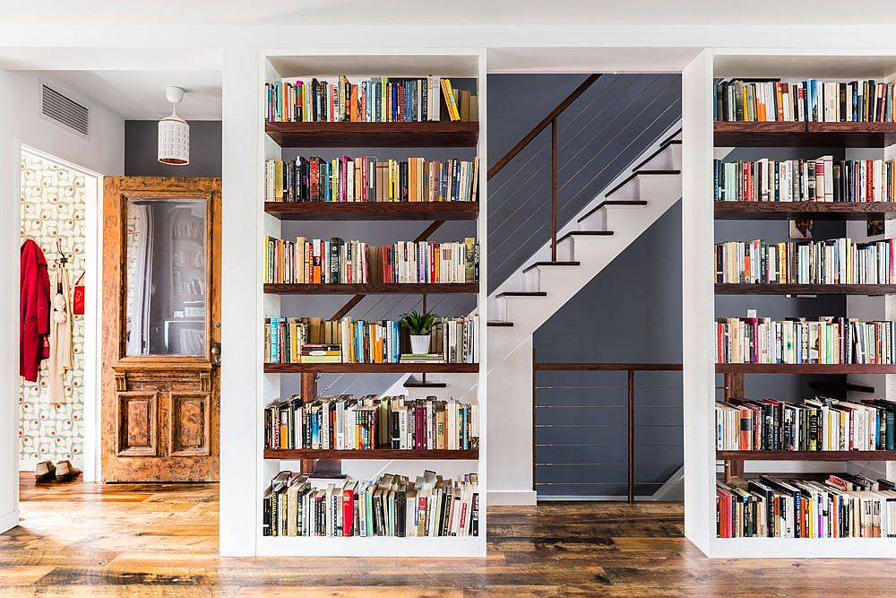 Cleverly placed twin bookshelves in the large living room make a big impact For the Love of Books and Music: Spacious Revamp of Aged Brooklyn Rowhouse