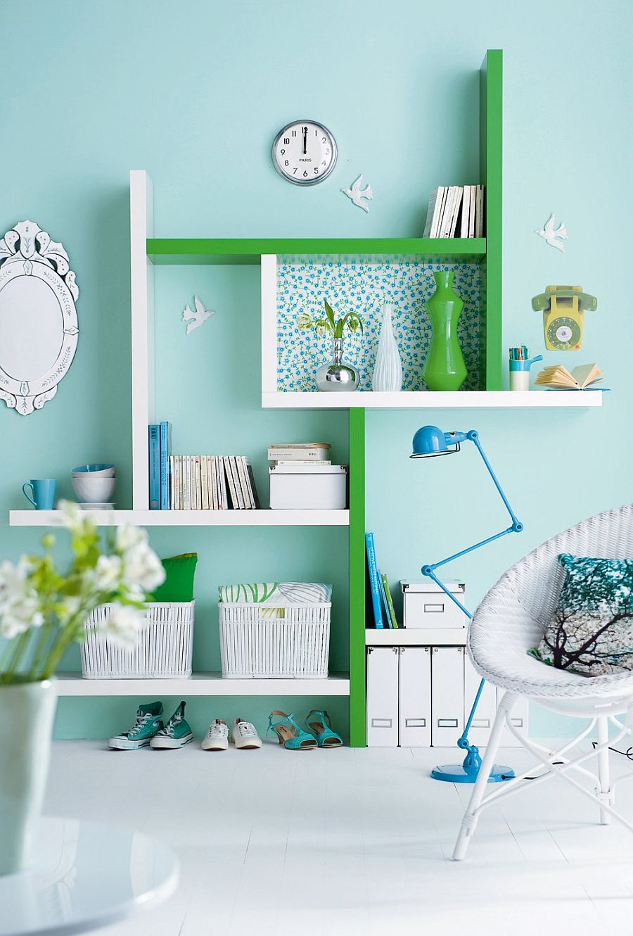 Colorful home office in pastel blue with pops of green