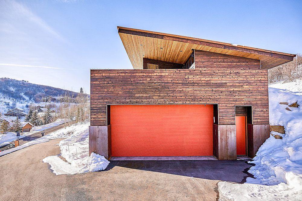Contemporary-garage-in-wood-with-bright-orange-doors