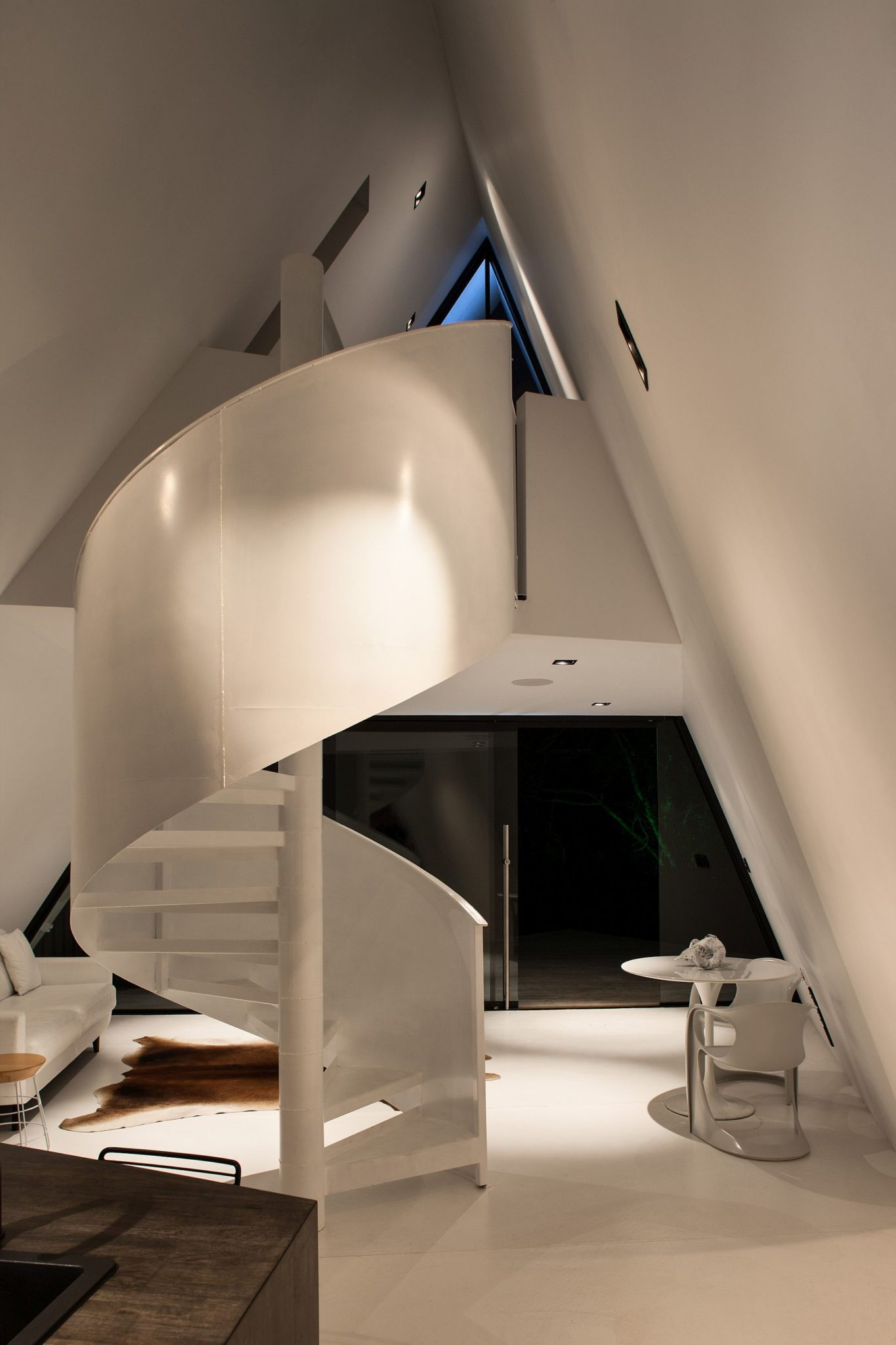 Contemporary interior in white with spiral staircase