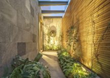 Covered-and-illuminated-walkway-connects-the-central-courtyard-with-the-garden-217x155