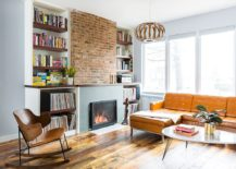 Custom shelves next to the brick wall section and fireplace holds vinyl records 217x155 For the Love of Books and Music: Spacious Revamp of Aged Brooklyn Rowhouse