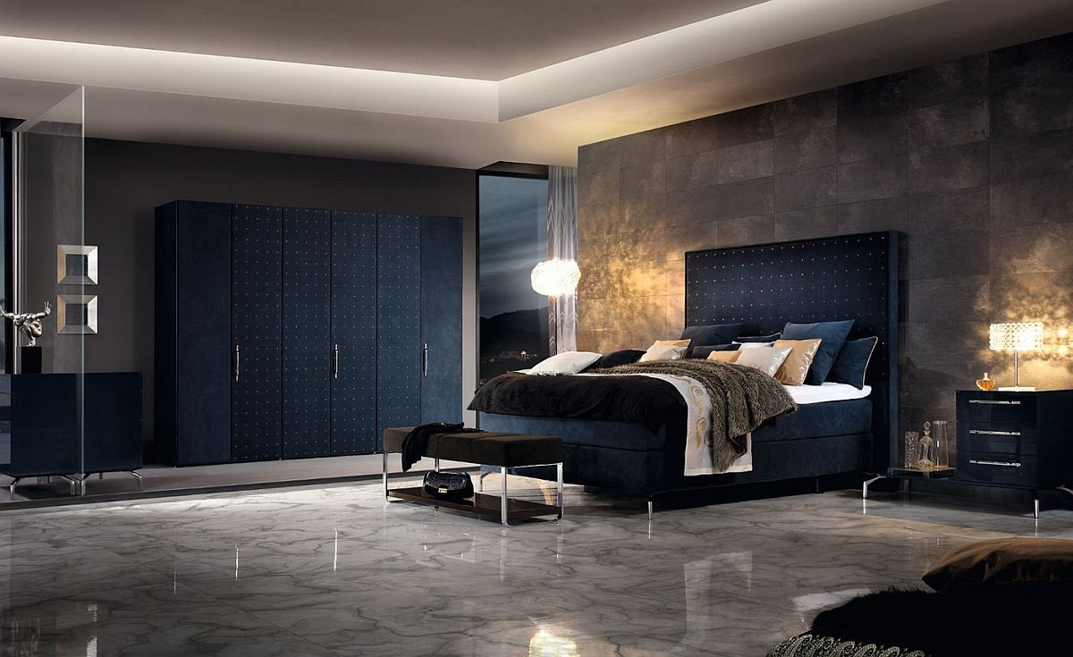 Dark blue and concrete combine seamlessly in this contemporary bedroom