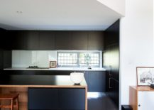 Dark-cabinets-of-the-kitchen-present-a-contrasting-image-217x155