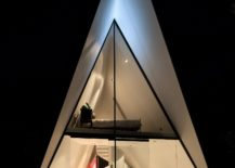 Dark-exterior-of-the-tent-house-allows-it-to-blend-into-the-backdrop-217x155
