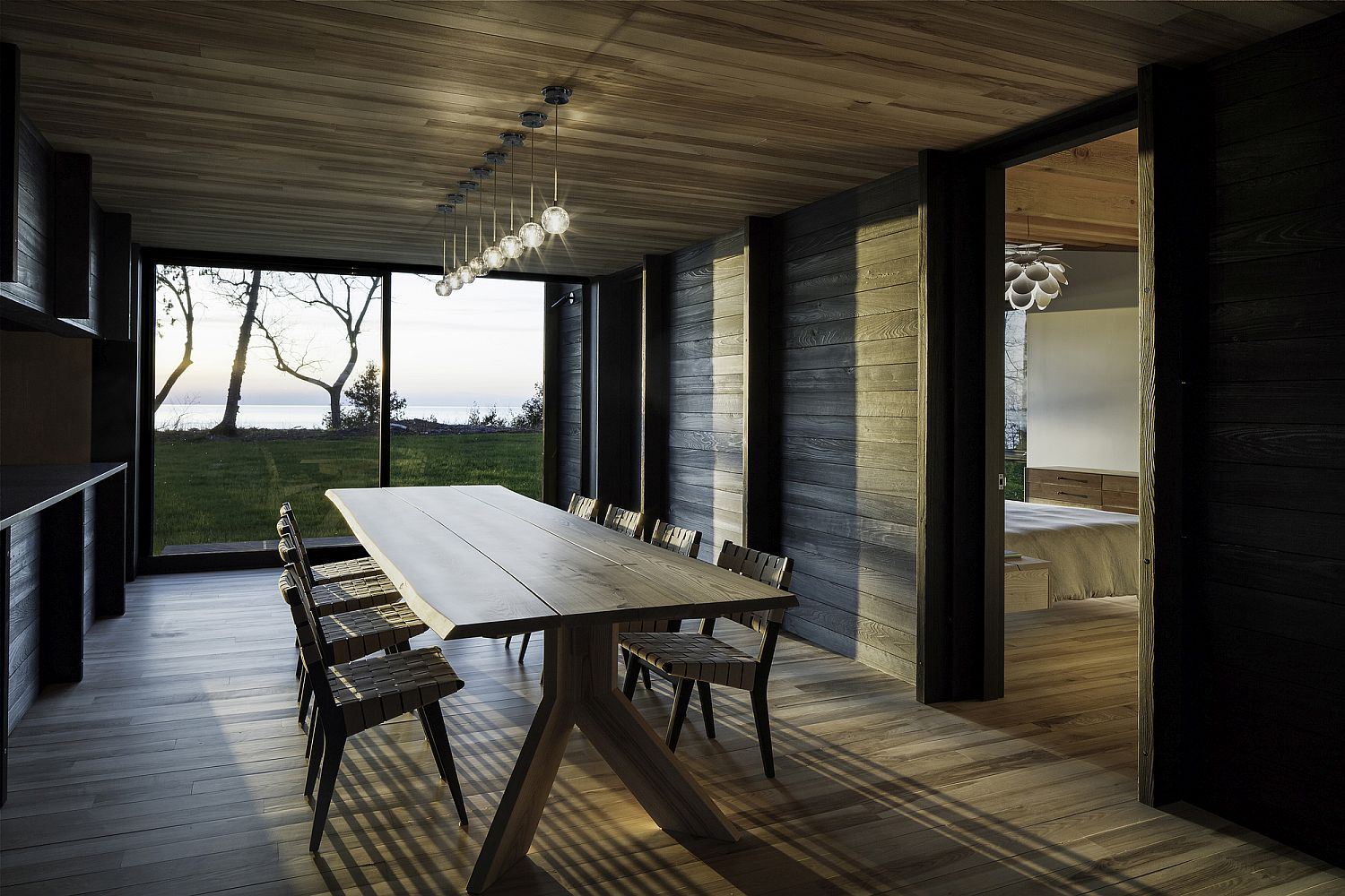 Dining-area-combines-rustic-wooden-decor-with-sparkling-lighting