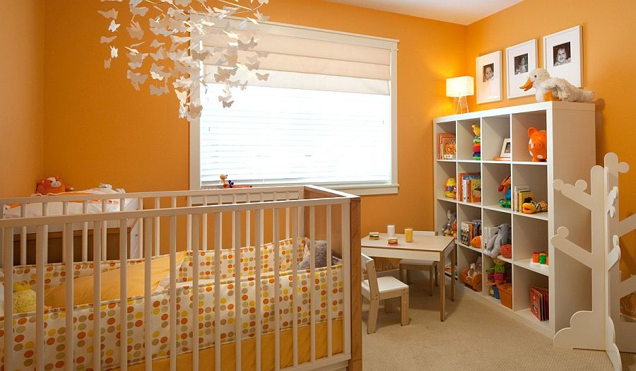 Even lighting adds to the ambiance of the all-orange nursery