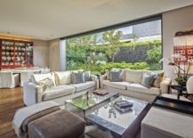 Exquisite-living-area-with-dining-space-next-to-it-and-a-fabulous-garden-outside-217x155