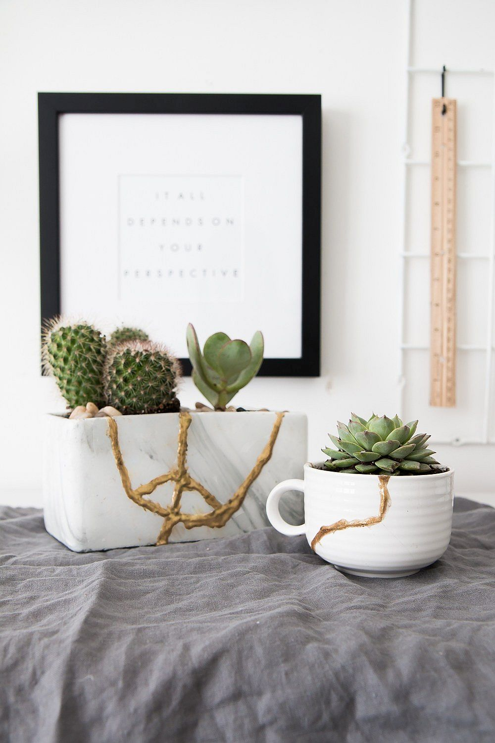 Fashionable DIY Kintsugi planters in glittering gold