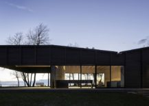Gently-undulating-roof-mimics-the-landscape-the-house-sits-in-217x155