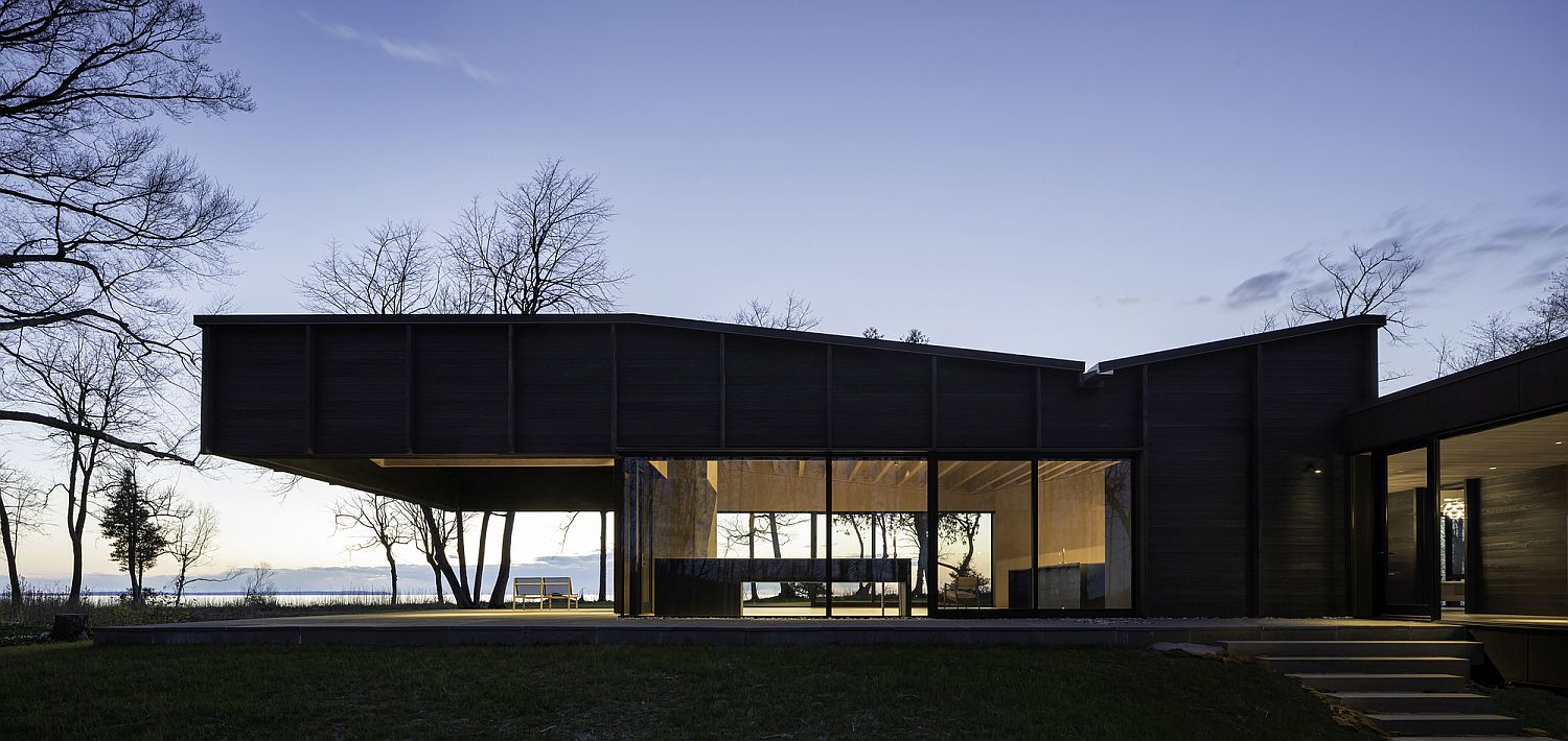 Gently undulating roof mimics the landscape the house sits in