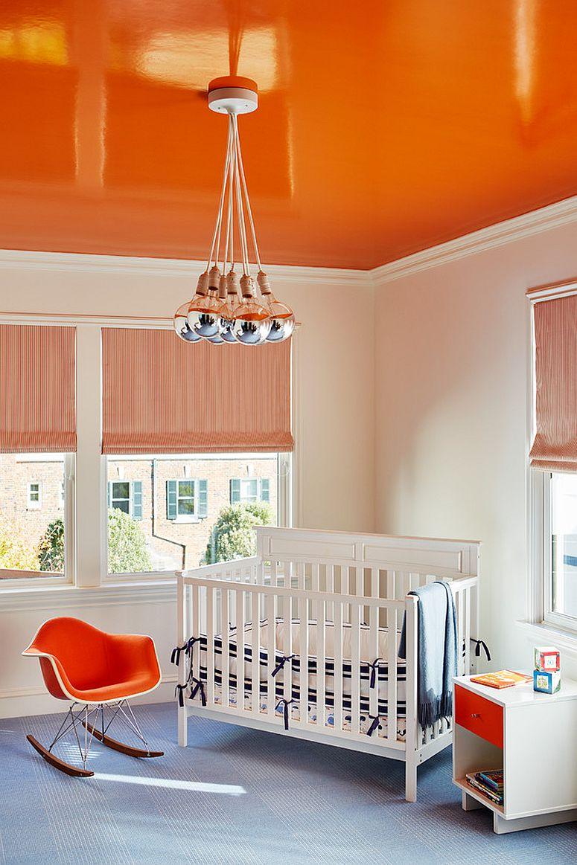Glossy orange ceiling for the modern nursery in white