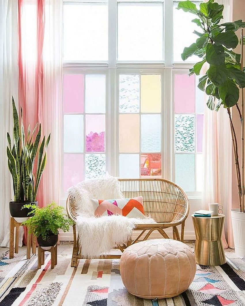 Gorgeous home office in lovely pastels with refreshing indoor plants