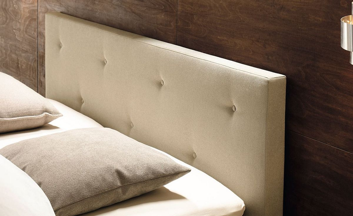 Gorgeous tufted headboard adds to the luxury of the lovely bed