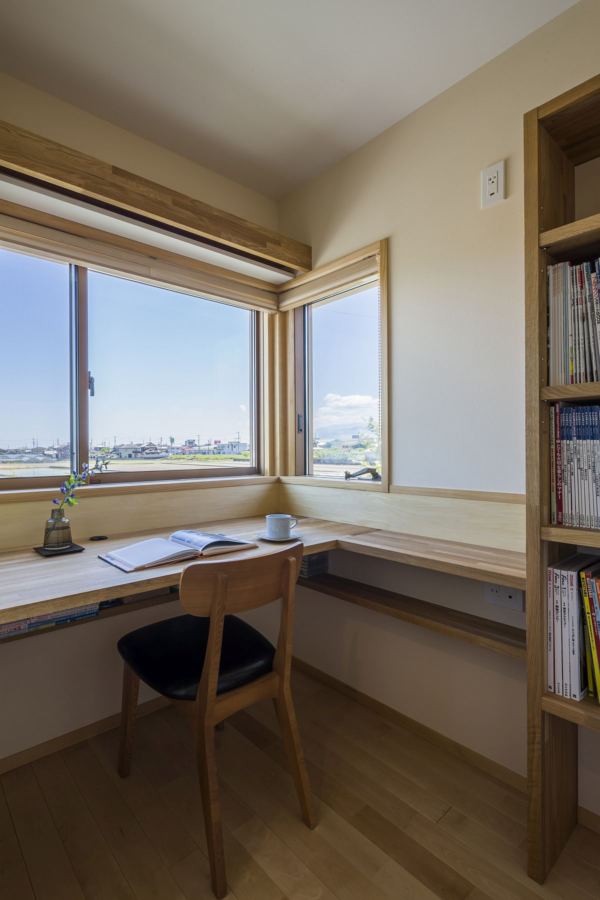 Home office with corner window that offers lovely view of the landscape