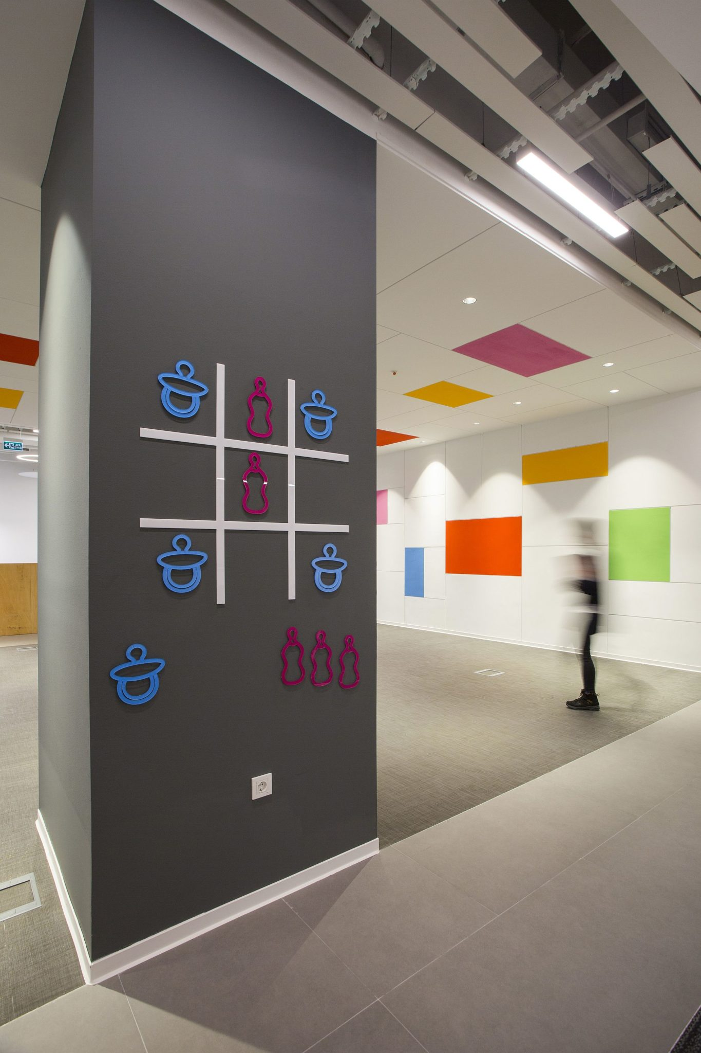 Innovative tic tac toe on the gray wall adds color to the interior