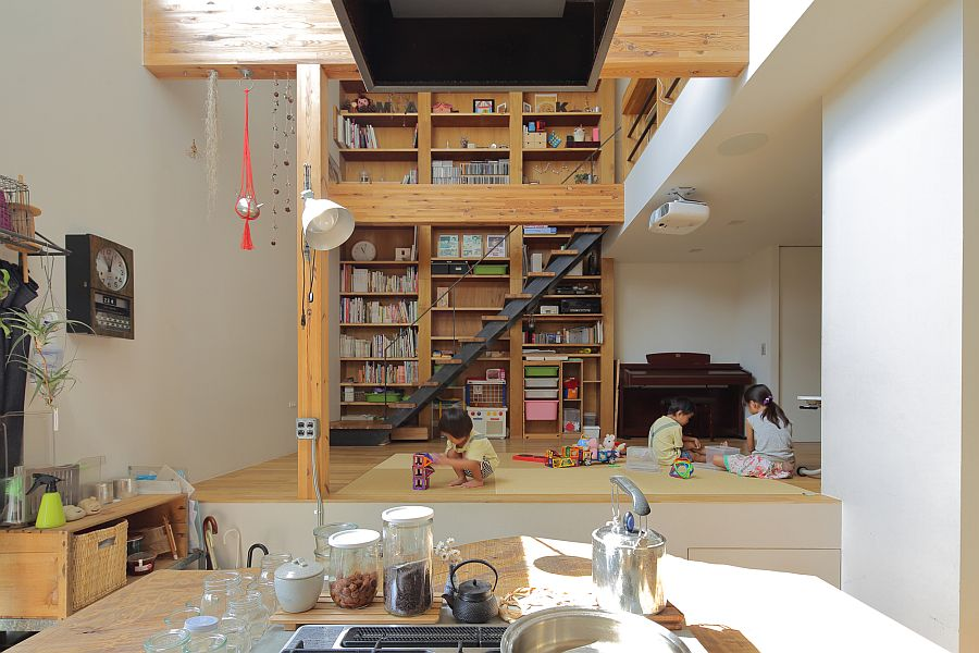 Kitchen and living area with bookshelf in the backdrop