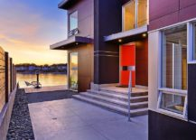 Lakeside-home-with-a-modern-entry-highlighted-using-a-bold-orange-door-217x155
