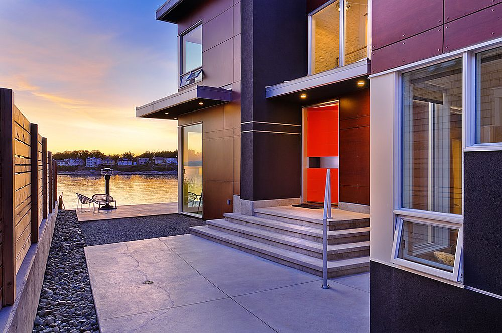Lakeside-home-with-a-modern-entry-highlighted-using-a-bold-orange-door