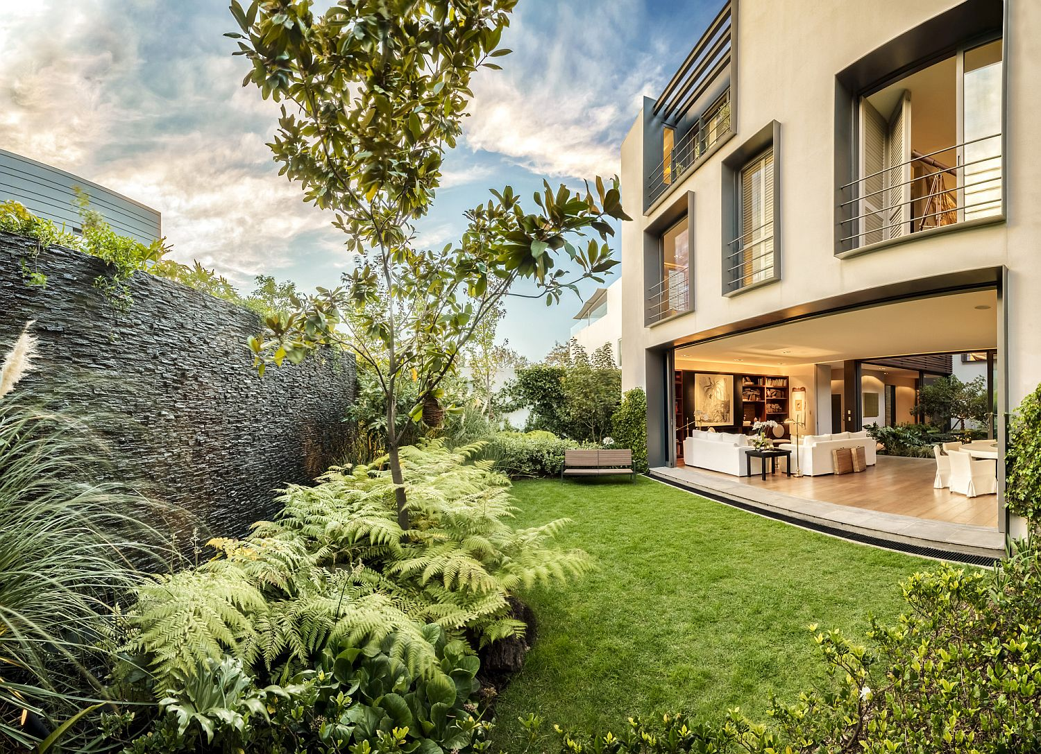 Lush green yard of private Mexican home becomes a part of interior
