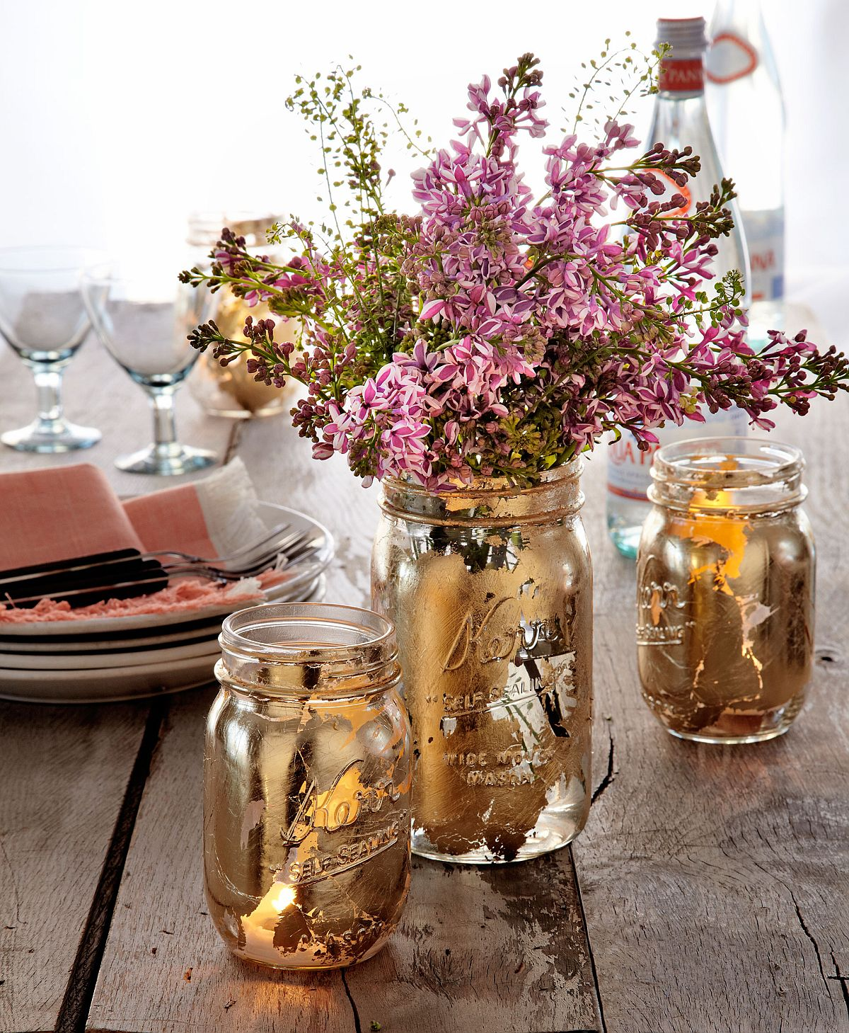 Mason jar painted in gold can double as perfect fall table centerpieces and cool planters!