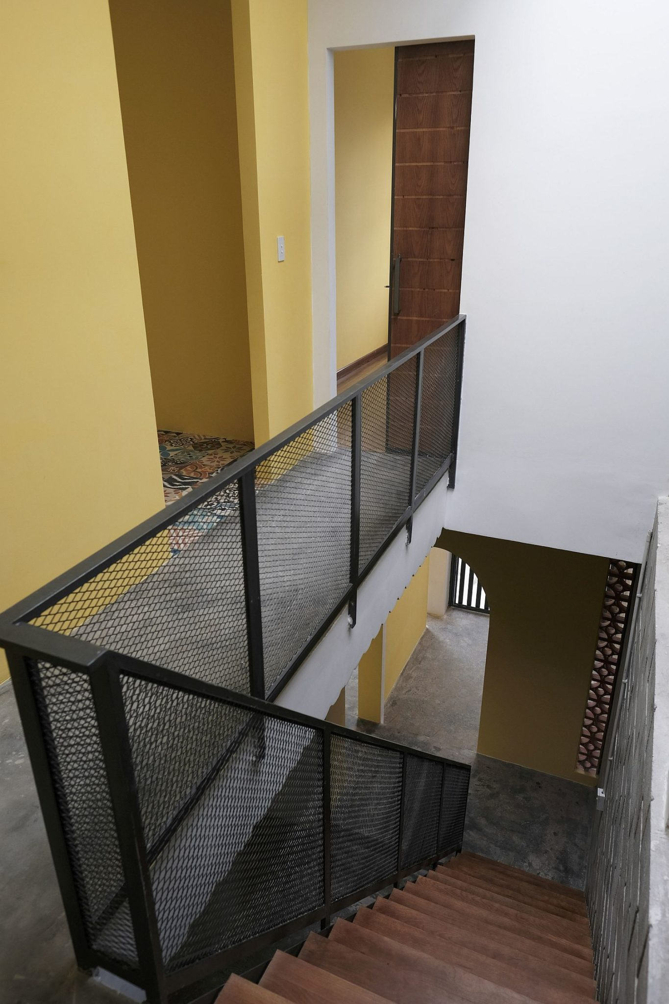 Metal sheet used as railing for staircase