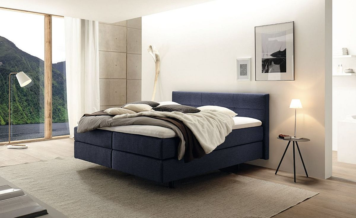 Modern bedroom in white with the Boxspring bed in blue