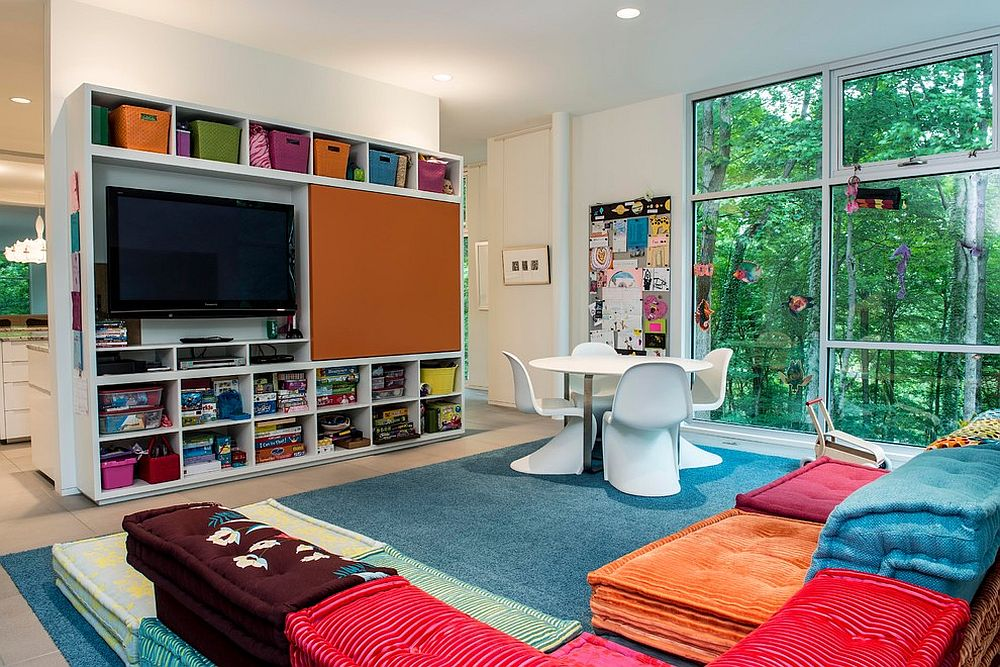 Modern kids' room and play area with colorful modular seating and plenty of natural light