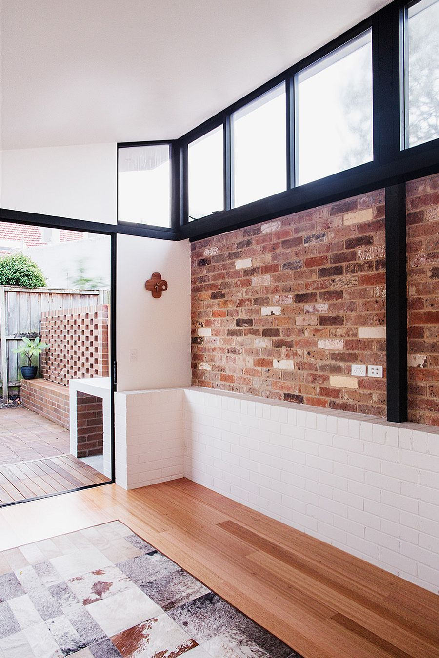 Old exposed brick wall is combined with recycled brick wall outside