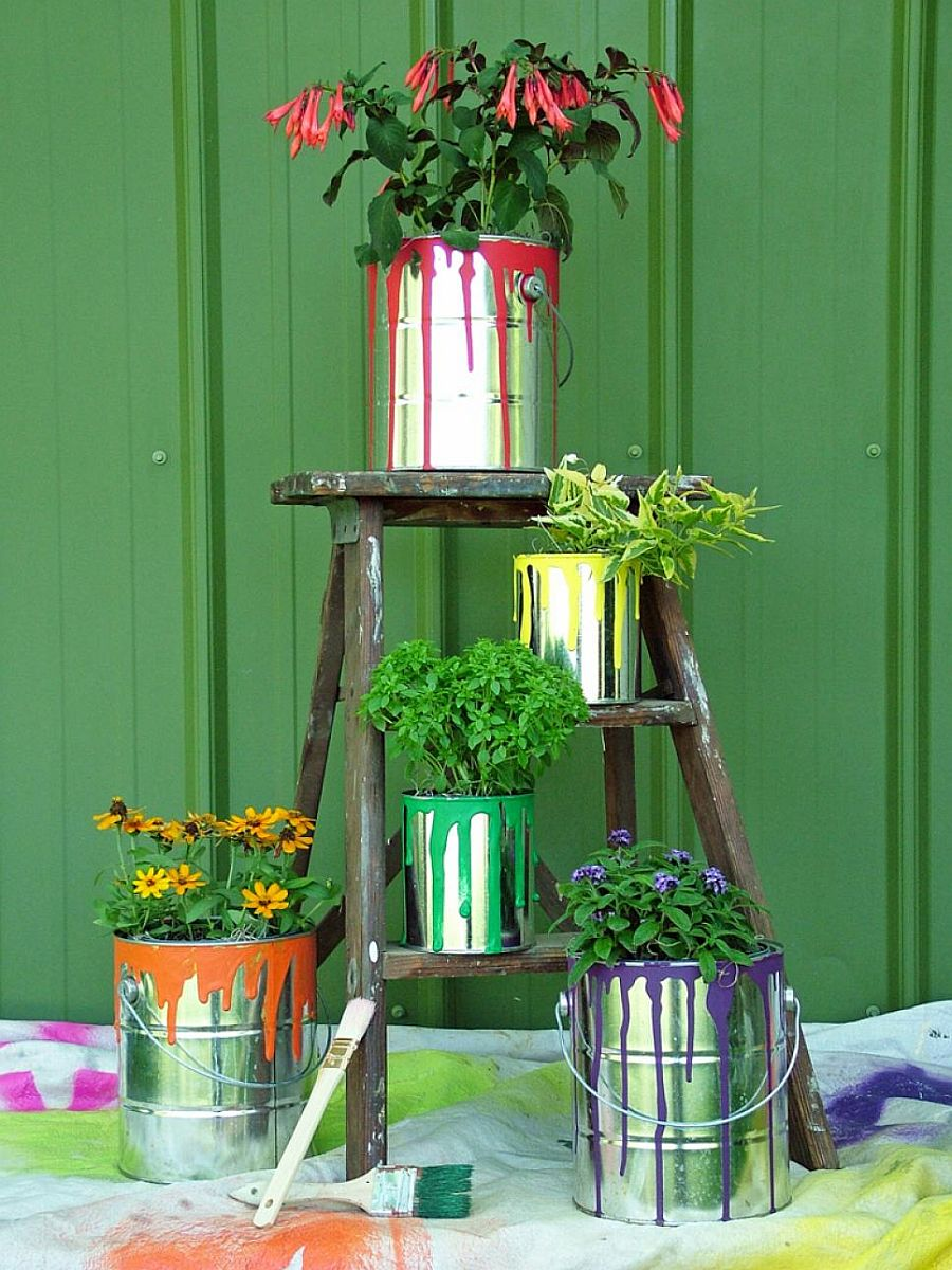 Old paint cans turned into planters bring both metallic dazzle and colorful zest