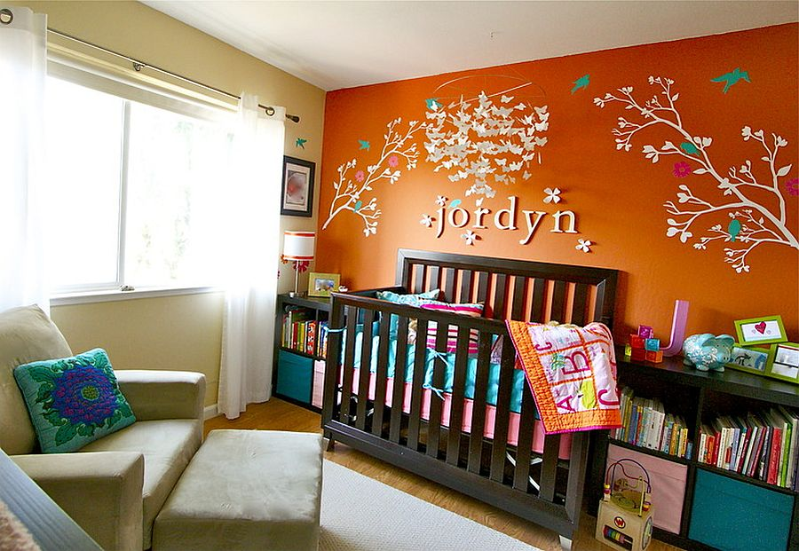 Orange accent wall for the modern nursery