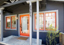 Orange-doors-and-window-frames-coupled-with-bluish-gray-exterior-for-an-eclectic-look-217x155