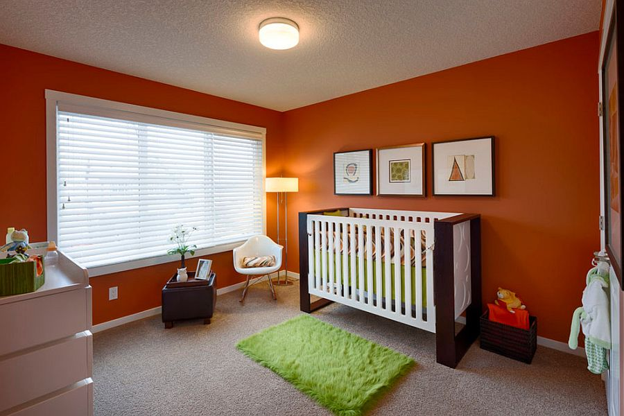 Orange gives the small contemporary nursery a more cheerful look