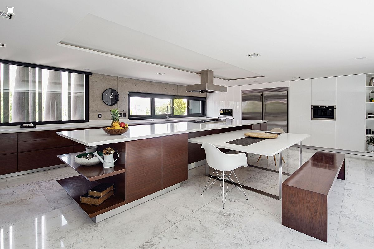 Polished modern kitchen in white with dark wooden cabinets and breakfast bench