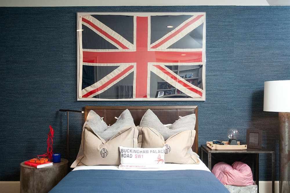 Polished teen room in blue with grasscloth wall covering and framed Union Jack