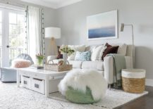 Small-and-chic-living-room-idea-in-white-with-a-light-gray-backdrop-217x155