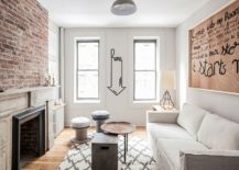 Small-living-room-in-white-of-New-York-City-apartment-with-exposed-brick-wall-217x155