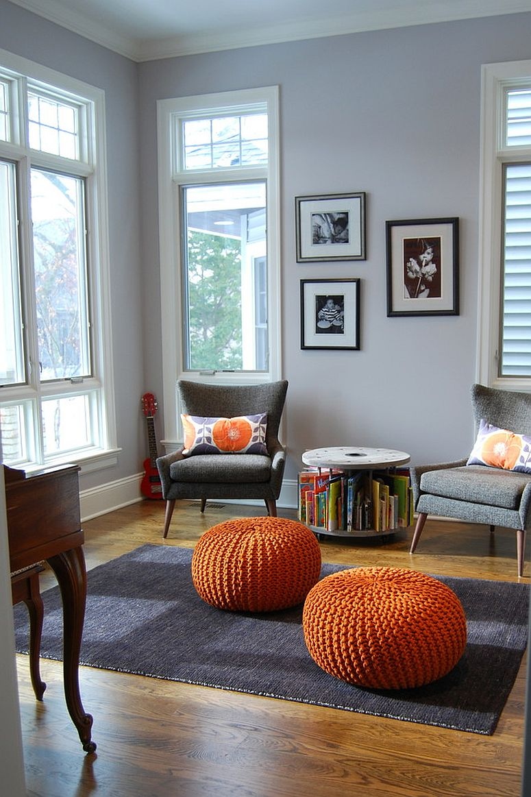 Small round table with book storage space is a great space-saver