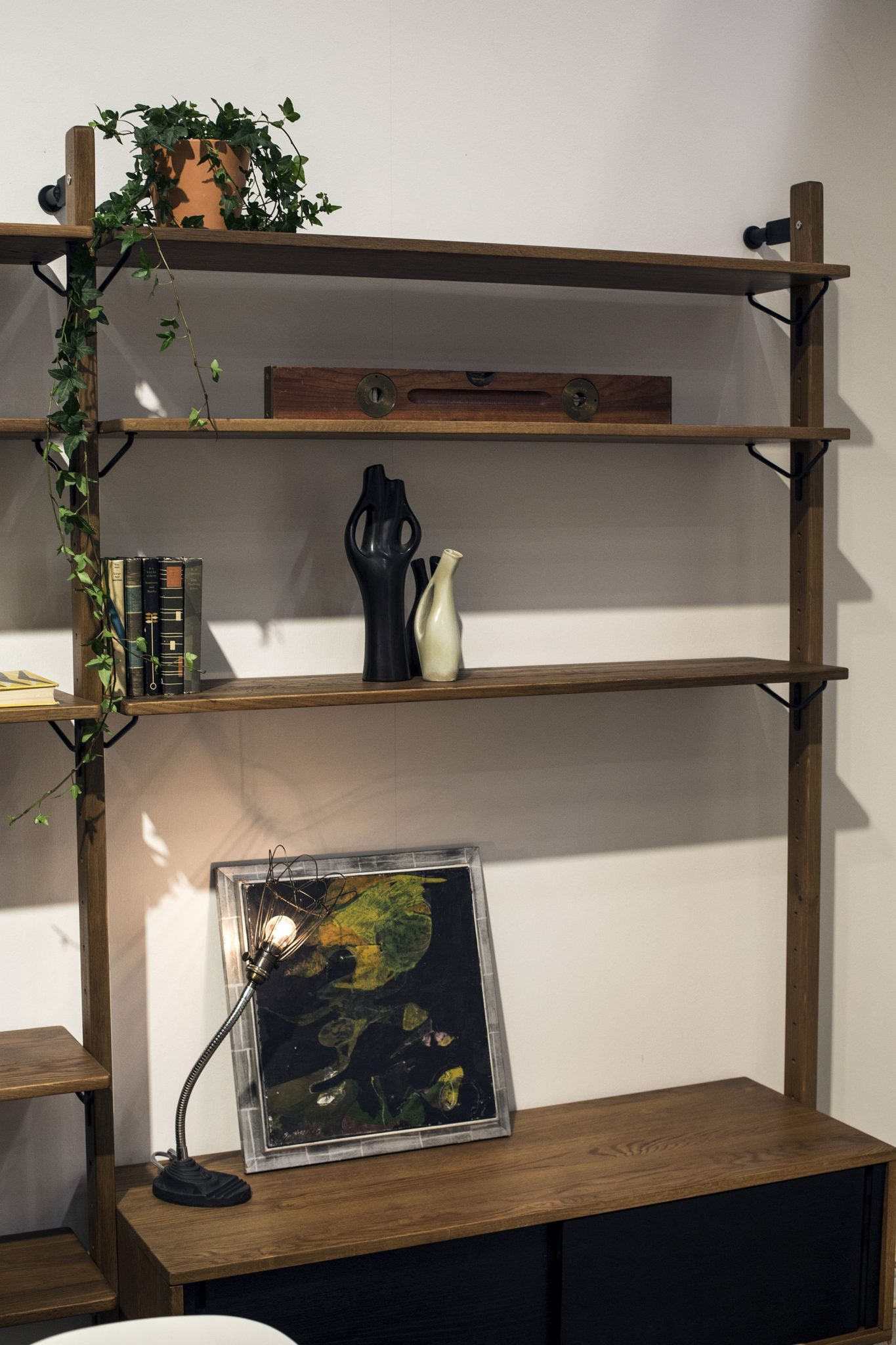 Space-savvy floating shelves add industrial charm to the modern living room
