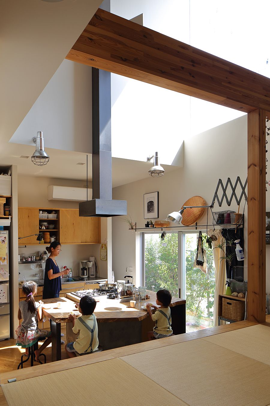 Spacious, double-height kitchen of the house also serves as the gathering space for entire family
