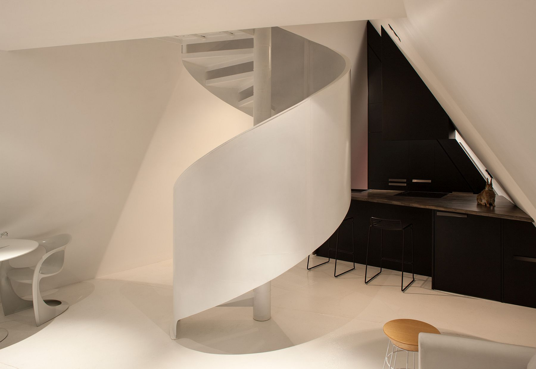 Spiral staircase in white inside the Tent House