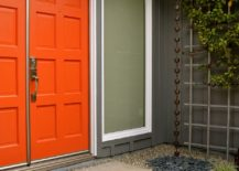 Stylish-Asian-entry-in-gray-with-bright-orange-door-217x155