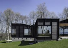 Unique-charred-wood-and-glass-exterior-of-the-lakeside-house-217x155