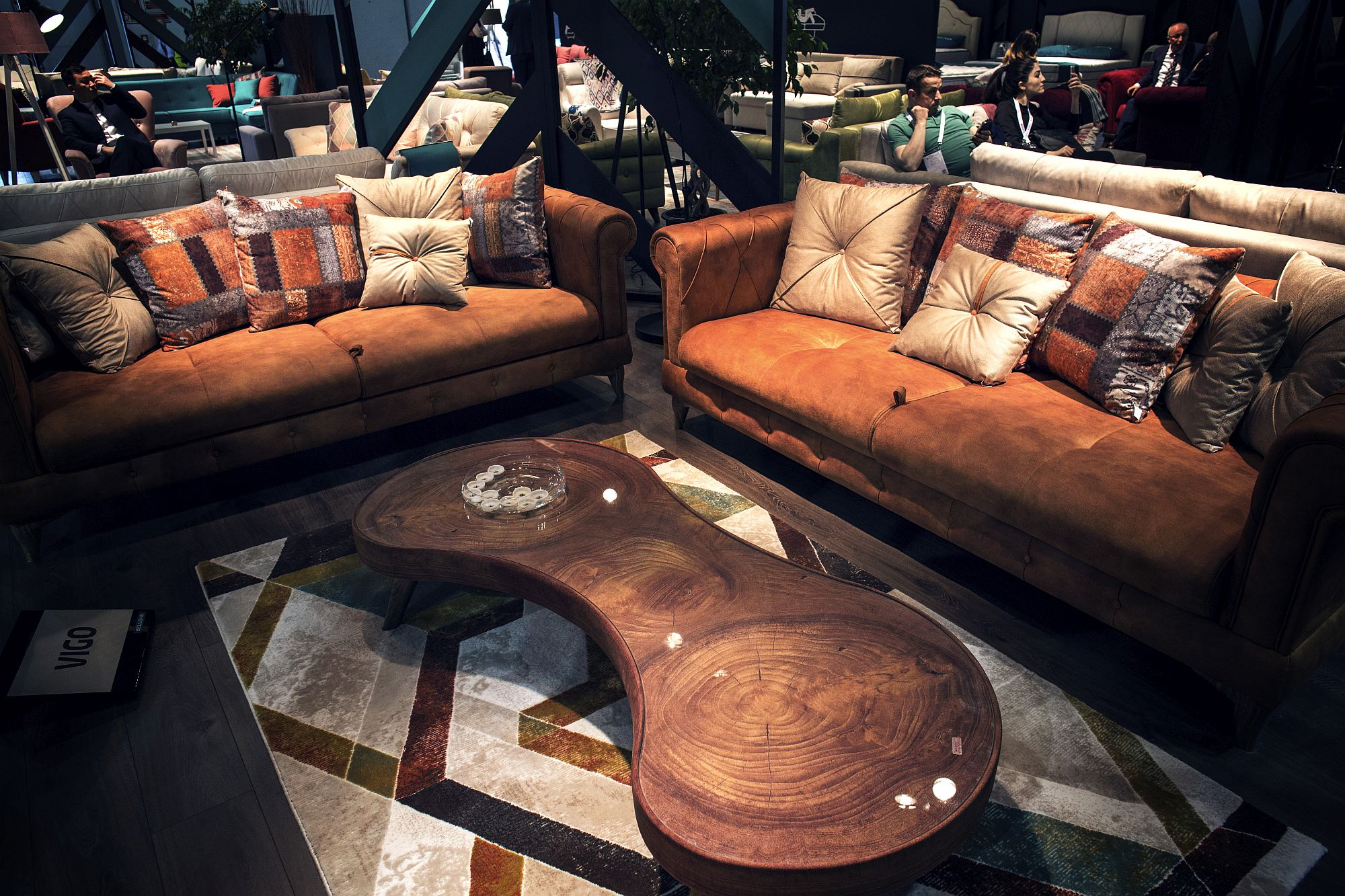 Unique wooden coffee table and leather sofas with jaded finish are perfect for the industrial style interior