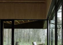 Warm-wood-interiors-and-large-floor-to-ceiling-sliding-doors-create-a-dashing-lakeside-home-217x155