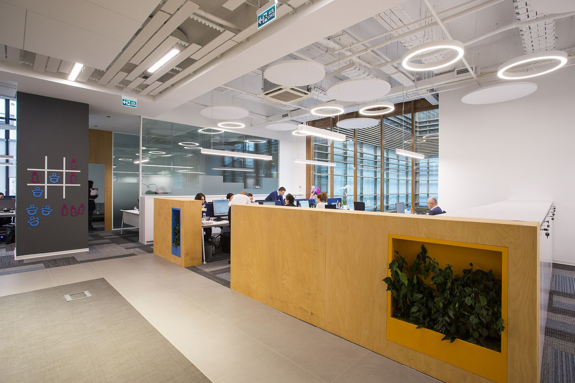 Wooden partitions with niches for indoor plants bring warmth to the contemporary office