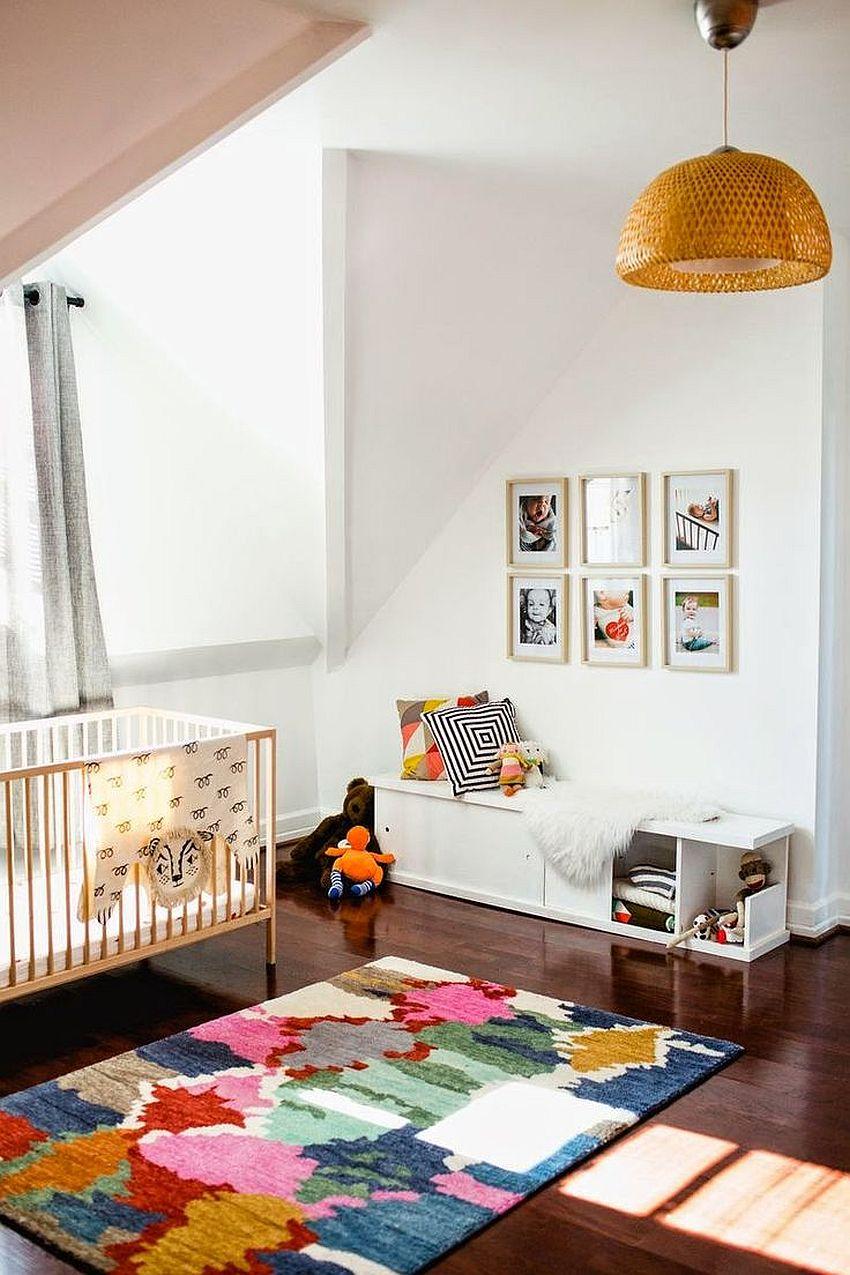 A patchwork of colors for the rug works well in any neutral, modern nursery